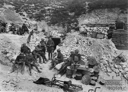 Intelligence officers from 4th Brigade AIF synchronising watches near Hamelet, 3 July 1918 (Australian War Memorial)