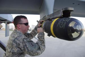 Signing a Hellfire missile attached to a MQ1-C (Gray Eagle) UAV at Bagram