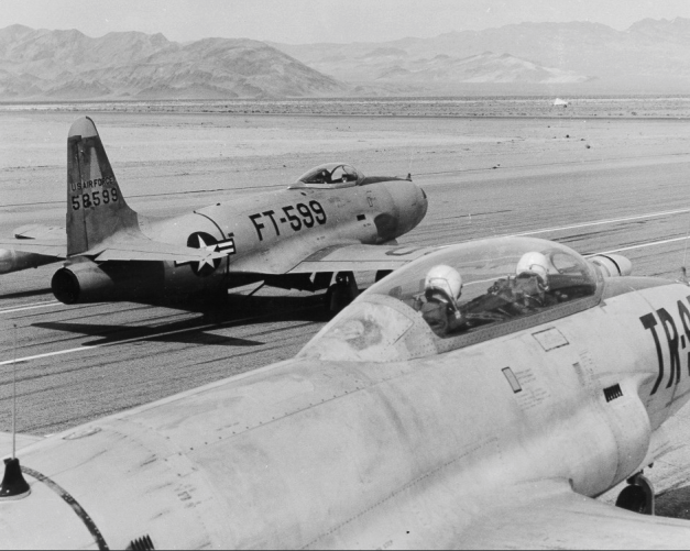 Lockheed QF-80 drone (FT-599) and director aircraft (a Lockheed DT33) ready for take-off at Indian Springs