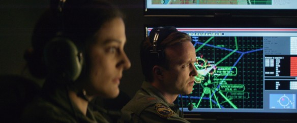 "This image released by Bleecker Street shows Phoebe Fox, left, and Aaron Paul in a scene from ""Eye In the Sky."" (Keith Bernstein/Bleecker Street via AP)"