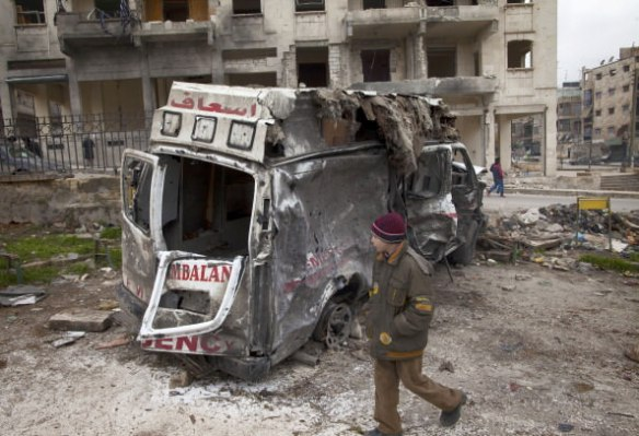 A Syrian youth walks past a destroyed ambulance in the Saif al-Dawla district of the war-torn northern city of Aleppo on January 12, 2013. An accident and emergency centre in Aleppo uses an abandoned supermarket to conceal a fleet of 16 ambulances, just 10 of which are in working order and are driven by 22 staff members. AFP PHOTO/JM LOPEZ/ (Getty Images)