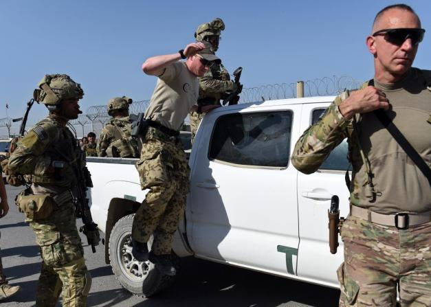 us-army-personnel-leave-a-truck-inside-afghan-military-base-kunduz-1-oct-2015